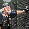 Vietnam Veteran Pays Respect To Fallen Soldiers At The Vietnam War Memorial  by B Christopher