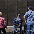 Vietnam Veterans Paying Respect To Fallen Soldiers At The Vietnam War Memorial by B Christopher