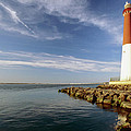 View Of A Red And White Lighthouse by George Oze