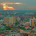 View Of Sun Setting Over Bangkok Buildings From Grand China Princess Hotel In Bangkok-thailand by Ruth Hager
