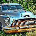 Vintage American Car In Yard by Olivier Le Queinec