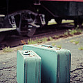 Vintage blue suitcases with red caboose by Edward Fielding