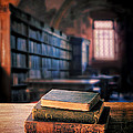Vintage Books And Glasses In An Old Library by Jill Battaglia