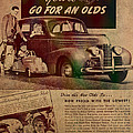 Vintage Car Advertisement 1939 Oldsmobile On Worn Faded Paper by Design Turnpike