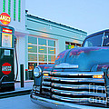 Vintage Chevrolet At The Gas Station by Todd Bandy