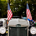 Vintage Ferguson Tractor With American Flags by Jon Woodhams