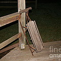 Vintage Sled On Log Cabin Porch by Amelia Painter