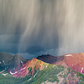 Virga And Storm Moving Over Mountains by Howie Garber