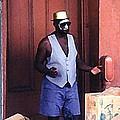 Voodoo Busker In New Orleans by John Malone