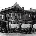 Wagon Train In Downtown Spokane - 1880 by Daniel Hagerman