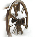Wagon Wheel In Snow by Lynn Sprowl