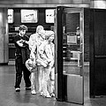 Waiting In Line At Grand Central Terminal 2 - Black And White by Gary Heller