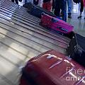 Waiting People Claim Baggage Airport Conveyor Belt by Stephan Pietzko