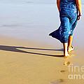 Walking On The Beach by Carlos Caetano