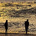 Strangers On A Shore - Walking Silhouettes by James Lavott