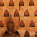 Wall Of Buddhas by Bob Christopher