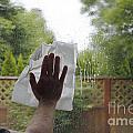 Washing A Window by Lee Serenethos