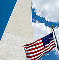 Washington Monument And Flag by Leslie Banks