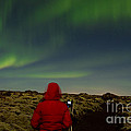 Watching The Northern Lights by Andres Leon
