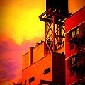Water Tower With Orange Sunset by Miriam Danar