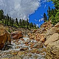 Waterfall In The Rockies by Dan Sproul
