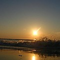 Wave crashing while the sun rises