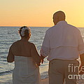 Wedding Couple Sunset by Michelle Powell