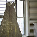 Wedding Dress And Veil By The Window by Mike Hope