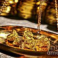 Weighing Gold by Olivier Le Queinec