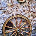 Wheel And Sun In Taromina Sicily by David Smith