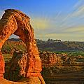 Whispy Clouds Over Delicate Arch by Markos Berndt