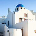 White Buildings And Blue Church In Oia Santorini Greece by Matteo Colombo