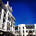 White Buildings On Blue Sky IIi by Hannah Rose