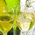 White Wine Pouring Into Glasses by Colin and Linda McKie