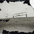 The Wright Brothers Wilbur In Motion At Left Holding One End Of Glider by R Muirhead Art