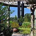 Wind Chime In A Garden by Mandy Judson
