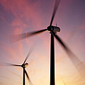 Wind Turbine Blades Spinning At Sunset by Johan Swanepoel