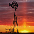 Windmill And Light Pillar by Rob Graham