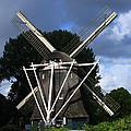 Windmill In Dutch Countryside by Aidan Moran