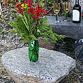 Wine And Red Flowers On The Rocks by Les Palenik