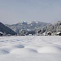 Winter Alpine Valley by Andrej Tarfila