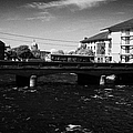 wolfe tone bridge and jurys hotel next to the quays on the corrib river Galway city county Galway Republic of Ireland by Joe Fox