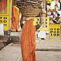 Woman Carrying Cow Dung In Basket On by Paul Miles