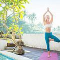 Woman Doing Yoga In The Morning by Nikita Buida