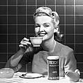 Woman Drinking Nescafe by Underwood Archives