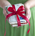 Woman Holding A Bundle Of Love Letters by Lee Avison