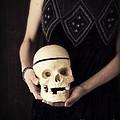 Woman Holding Skull by Edward Fielding
