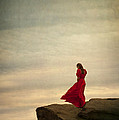 Woman In A Vintage Red Dress On A Windy Clifftop by Lee Avison