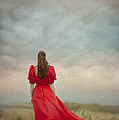 Woman In Red On Moorland by Lee Avison