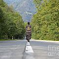 Woman On A Road by Mats Silvan